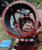 Phil harrington looking down the barrel of a Dobsonian reflecting telescope (32398 bytes)