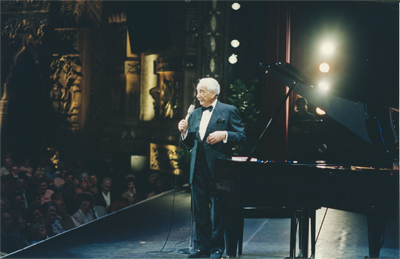 Victor Borge alongside an Imperial Bosendorfer piano