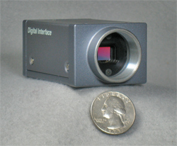 CCD camera with quarter for scale (31,561 bytes)